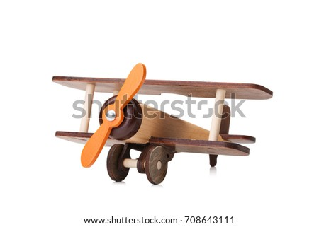 Close-up of an eco-friendly product for children's games, isolated on a white background. A developing toy airplane.
