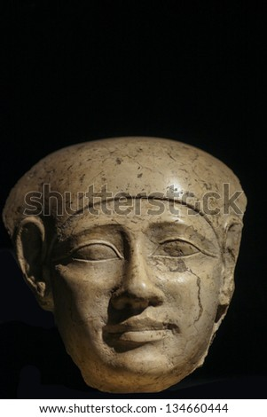 Close up of an Egyptian stone head of 400 BC