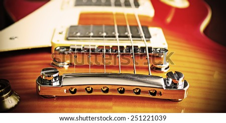 close up of an electric guitar bridge in vintage effect