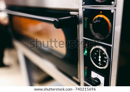 Close-up of an electric oven for pizza making. Concept cafe, restaurant