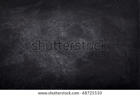 close up of an empty school chalkboard - stock photo