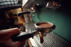 Close-up of an espresso apparatus for making aromatic and fragrant beverage. Coffee, beverage, bar