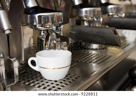 Close-up of an espresso machine making acup of coffee