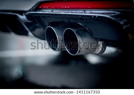 Close up of an exhaust pipe of a car, environmental pollution #1411167350