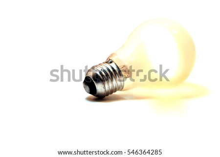 Close up of an incandescent lit bulb isolated on a white background
