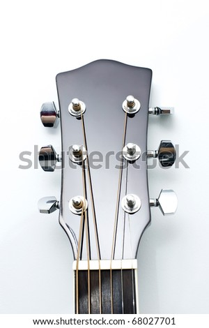 Close up of an new acoustic guitar head,  isolated on white background.