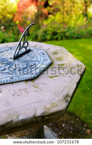 Close up of an octagon sundial in an English country garden.