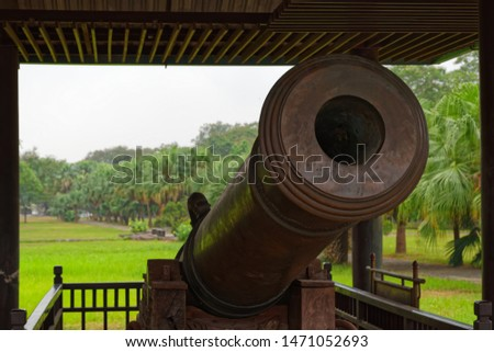 Close-up of an old antique cannon. This cannon is exhibited in a public park located near to Purple Forbidden City (Imperial City) in Hue in Central Vietnam #1471052693