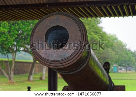 Close-up of an old antique cannon. This cannon is exhibited in a public park located near to Purple Forbidden City (Imperial City) in Hue in Central Vietnam #1471056077