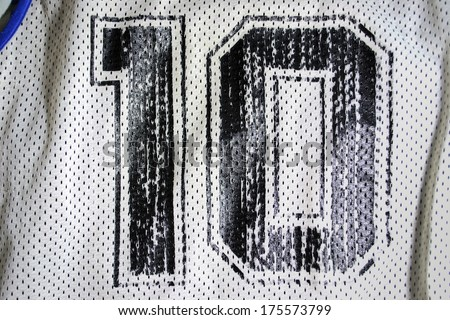 close up of an old basketball jersey number ten