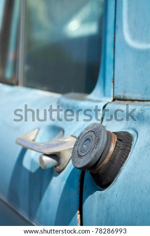Close-up of an old blue truck fuel cap