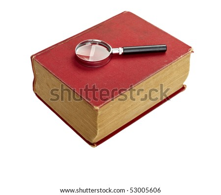 close up of an old book  and magnifying glass on white background with clipping path