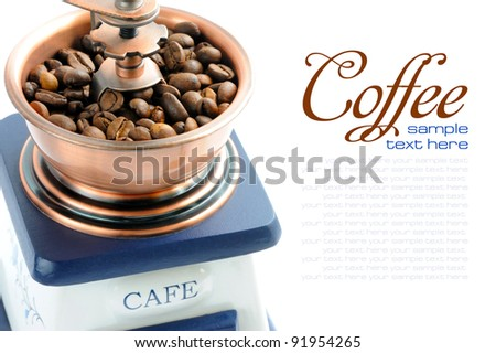 Close-up of an old-fashioned coffee grinder with space for text