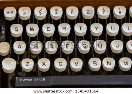 Close up of an old fashioned typewriter keyboard #1545401564