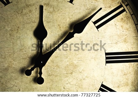 Close up of an old-fashioned wall clock. Studio work.
