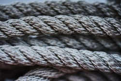 Close-up of an old frayed boat rope as a nautical background