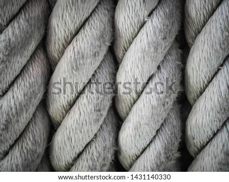 Close-up of an old frayed boat rope as background, Spiral of rope, Coiled rope on boats deck. #1431140330