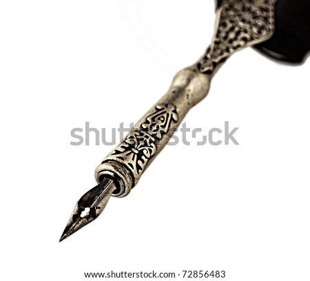 Close up of an old pen over white background