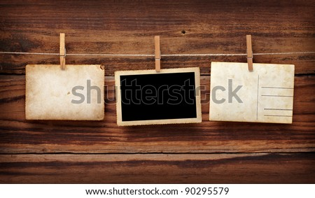 close up of an old photo and clothes peg on a wooden background