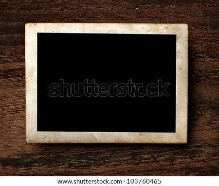 close up of an old photo on a wooden background