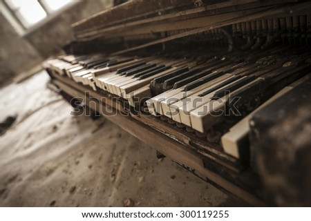 Close-up of an old piano keyboard in an abandoned auditorium in Pripyat. Chernobyl nuclear power plant zone of alienation