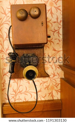 Close up of an old telephone on a wall #1191303130