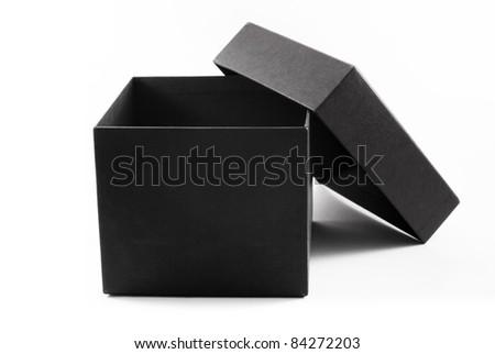 Close-up of an open black gift box, isolated - stock photo