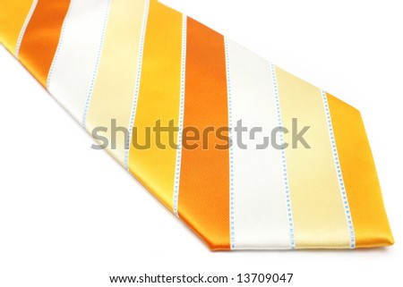 Close up of an orange necktie with stripes on white background.