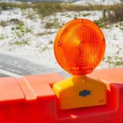 Close-up of an orange traffic reflector