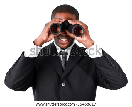 Close-up of an smiling Afro-American businessman looking through binoculars