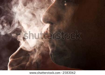 close up of an smoking man