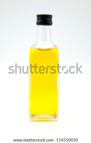 Close up of an unopened bottle of high quality, extra virgin olive oil.