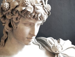 Close up of Ancient Greek Roman sculpture of Antinous dressed as god of wine Dionysus lover of Emperor Hadrian