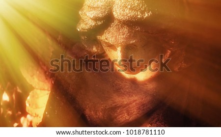 Close up of ancient statue wonderful angel in the rays of the sun (architecture, archetype, religion, faith concept)