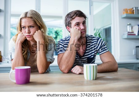 Close up of annoyed couple ignoring each other in the kitchen