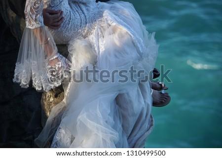 Close Up of Anonymous Bridal Couple figuratively Taking the Plunge at Diamond Bay, Sydney, Australia