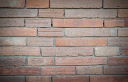 Close-up of antique brick block wall textured pattern with vignetted for backgrounds and text design.