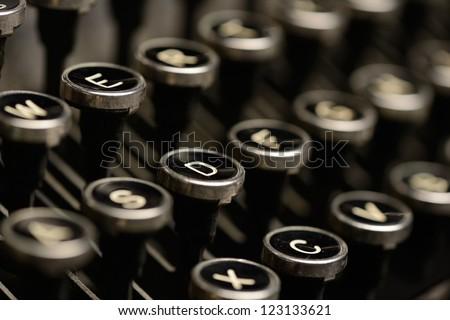 Close-up of antique typewriter keys. Close-up of keys on an old typewriter. Very shallow DOF.