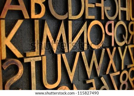 close up of antique wood letter ...