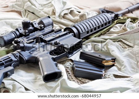 Close-up of AR-15 rifle and magazines with ammo