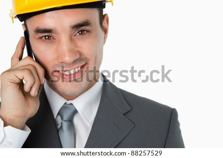 Close up of architect calling customer against a white background - stock photo