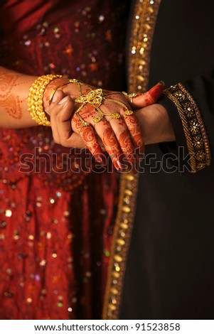 Close up of Asian couple's hands at a wedding, concept of marriage/partnership/commitment