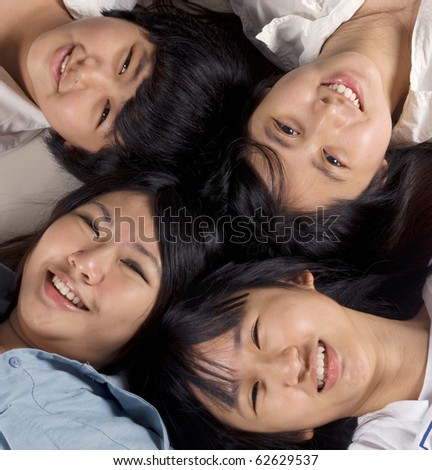 close up of asian girls lying on the floor