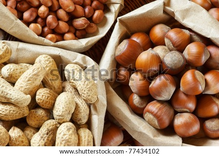Close-up of assorted nuts in paper bags.