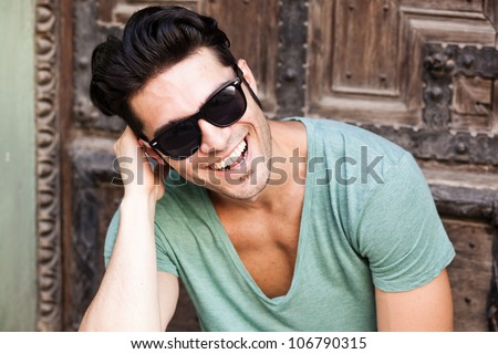 close-up of attractive man smiling wearing sunglasses #106790315