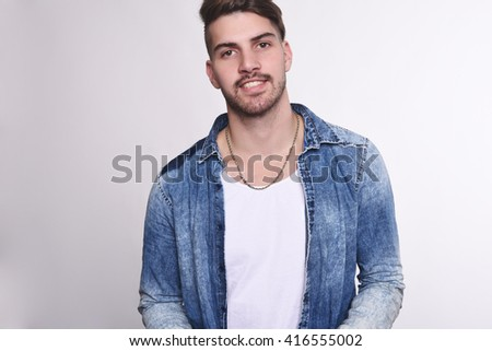 Close up of attractive young man. Isolated white background. #416555002