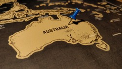 Close up of Australia map with blue pin.
