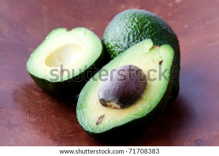 Close-up of avocados on a wooden background