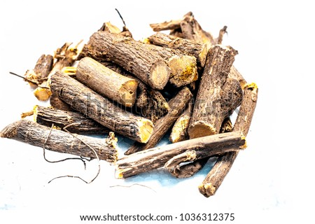 Close up of Ayurvedic herb Liquorice root,Licorice root, Mulethi or Glycyrrhiza glabra root isolated on white is very much beneficial for Soothes your stomach,poisoning, stomach ulcers, etc.