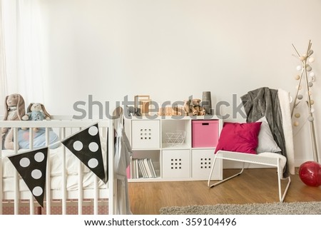 Close-up of baby furniture in girl\'s room